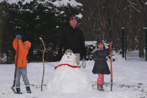 My family building a snowman.
